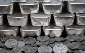 Silver Coins And Silver Bullion Bars Of Thick Silver
